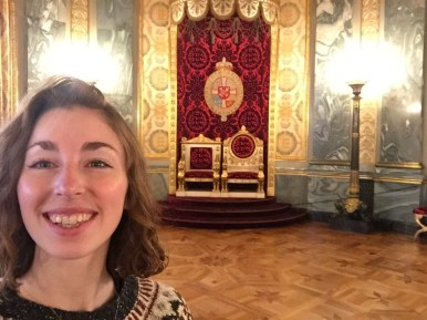 A selfie next to the chairs that the King and Queen would sit on while receiving guests